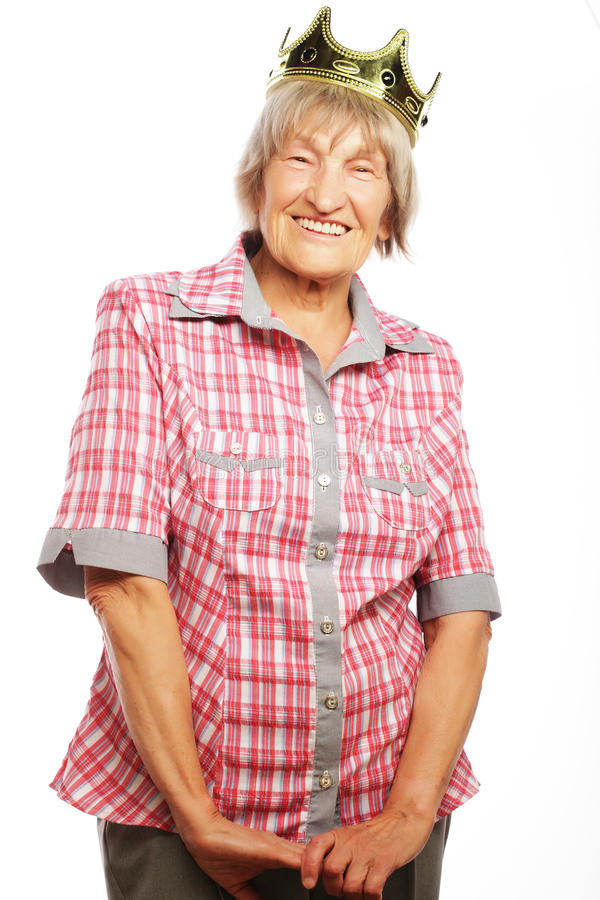 Senior woman wearing crown doing funky action stock images