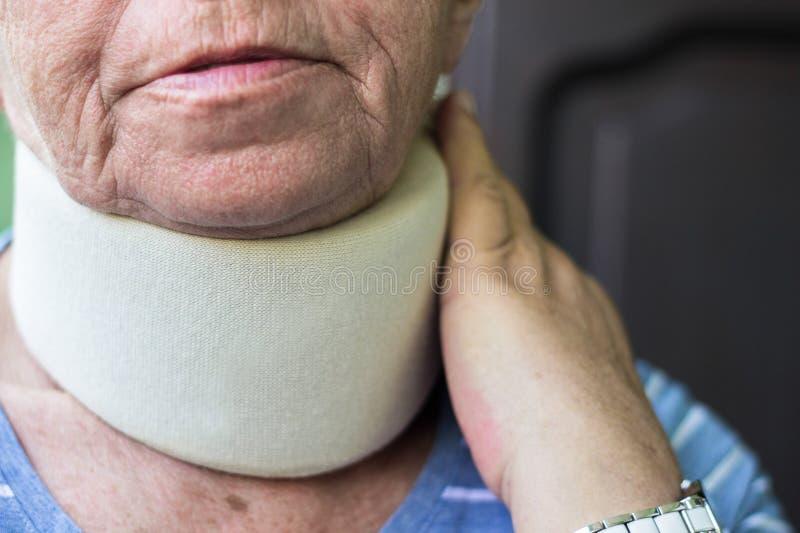 Senior woman wearing neck brace. Senior woman has emotional stress stock photography