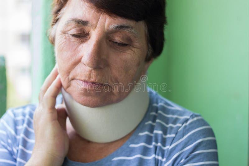 Senior woman wearing neck brace. Senior woman has emotional stress royalty free stock images