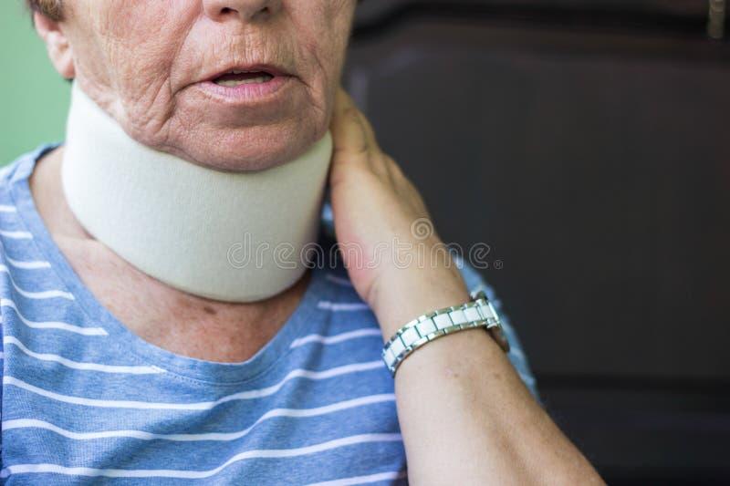 Senior woman wearing neck brace. Senior woman has emotional stress stock photo
