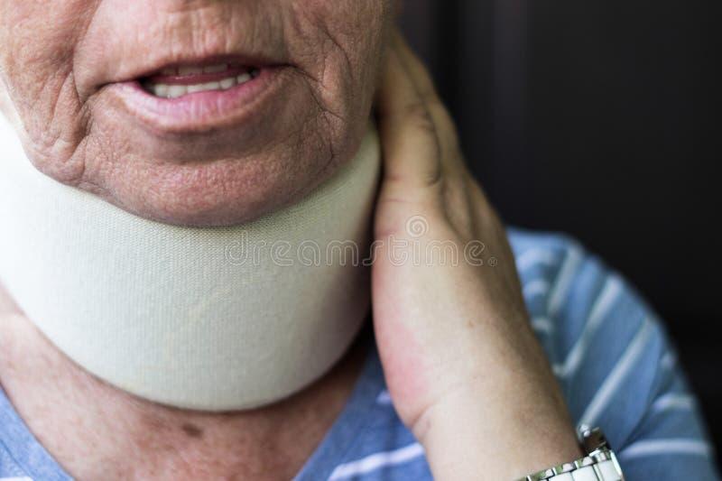 Senior woman wearing neck brace. Senior woman has emotional stress royalty free stock photography