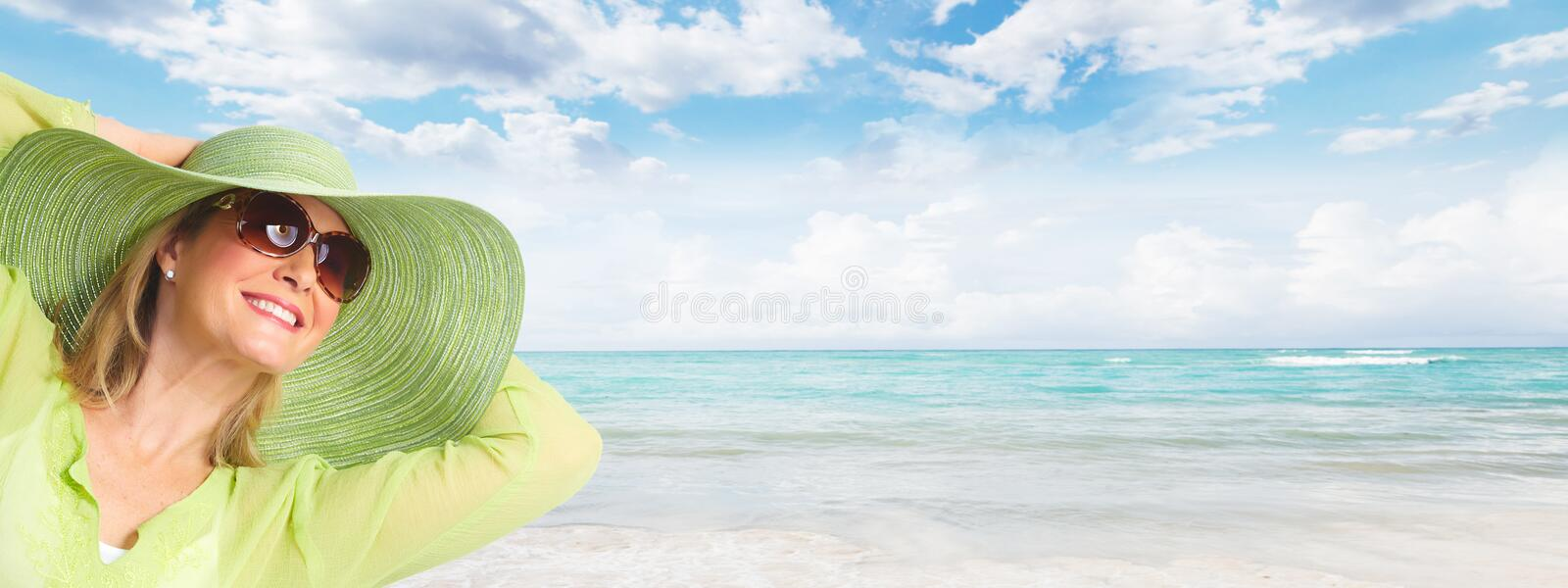 Senior woman wearing sunglasses and a hat. Vacation stock photo
