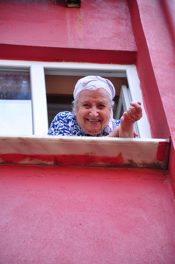 Senior woman at window royalty free stock image
