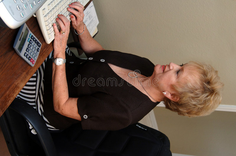 Senior woman working in office royalty free stock photos