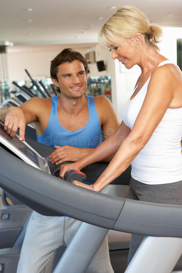 Senior Woman Working With Personal Trainer stock photo
