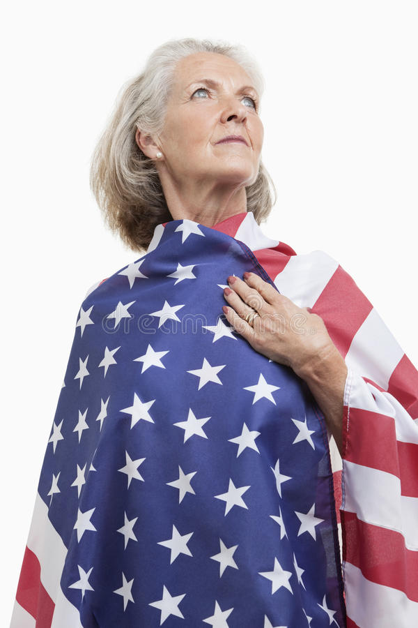 Download Senior Woman Wrapped In American Flag Against White Background Royalty Free Stock Images - Image: 30855149