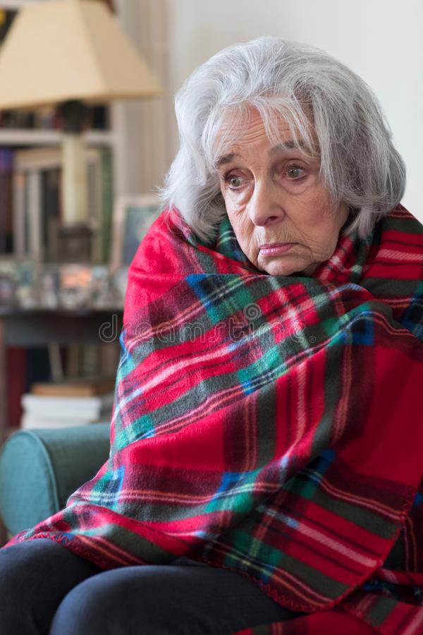 Senior Woman Wrapped In Blanket Unable To Afford Heating Bills stock image