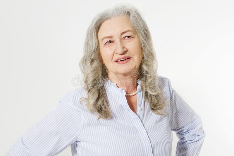 Senior woman with wrinkle face isolated on white background. Mature healthy lady. Copy space. Seniors lifestyle and old people. Happy concept stock images