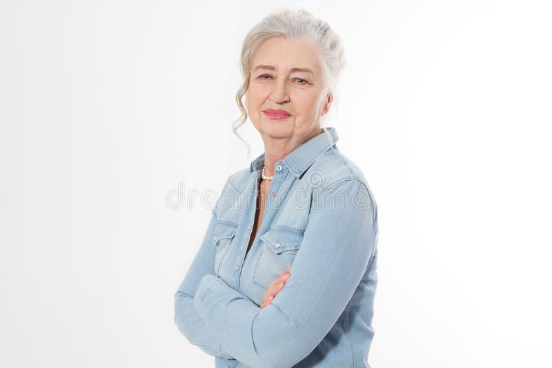 Senior woman with wrinkle face isolated on white background. Mature healthy lady. Copy space. Seniors lifestyle and old people. Happy concept royalty free stock photography