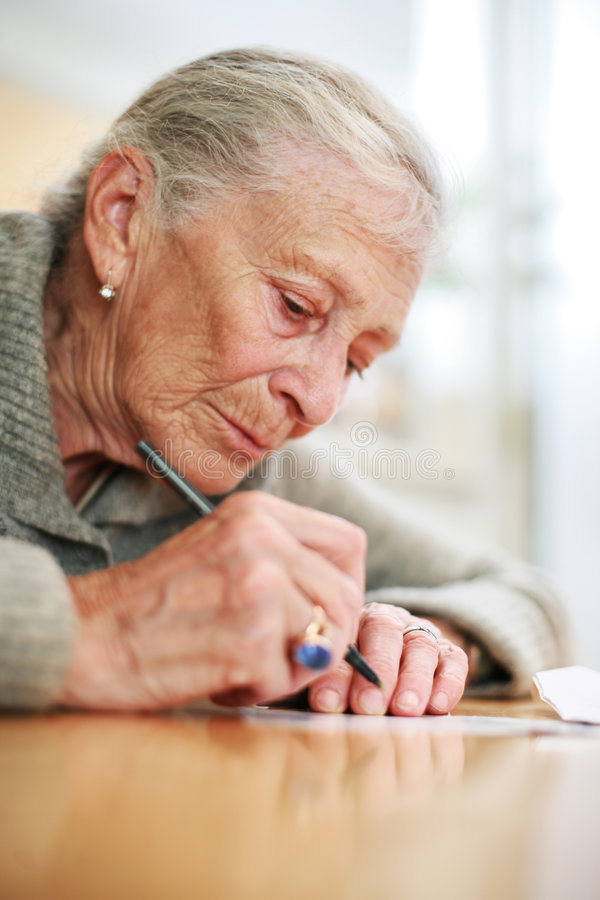Free Senior Woman Writing Royalty Free Stock Image - 3604826