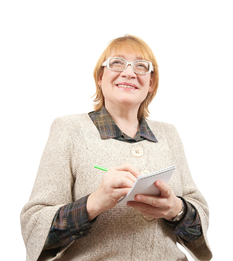 Senior Woman Writing On A Notebook Royalty Free Stock Image