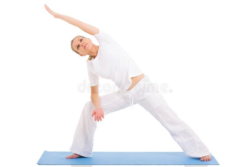 Senior woman yoga. Fit senior woman yoga on white background royalty free stock images