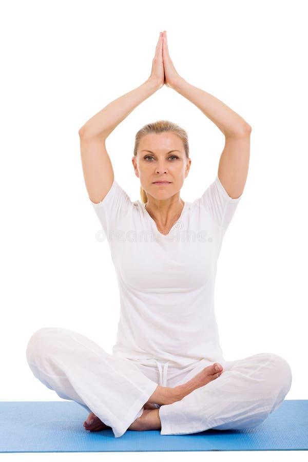Senior woman yoga meditating. Over white background royalty free stock photography
