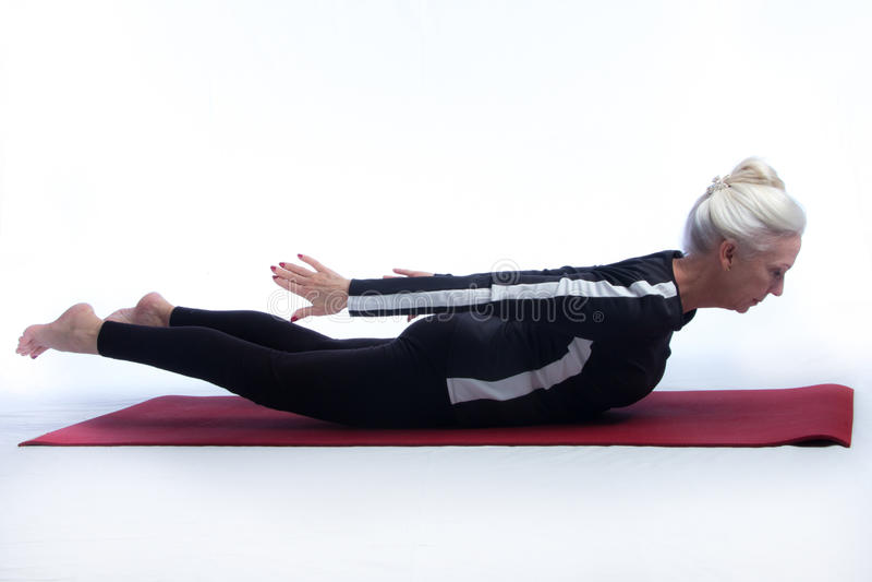 Senior Woman in Yoga Pose royalty free stock photo