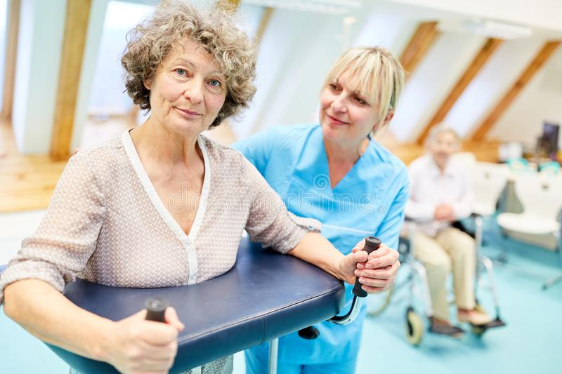 Senior woman as a patient is doing a rehab stock image