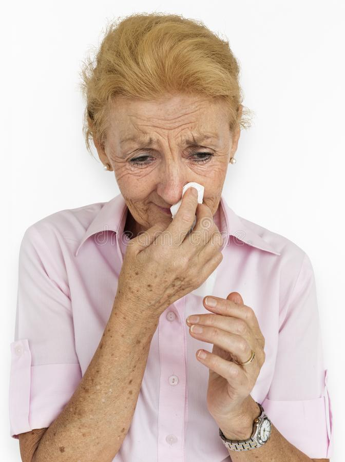Senior Women Blowing Nose Concept stock photo