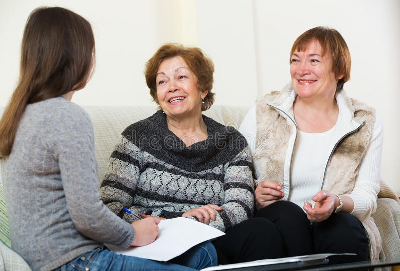 Senior women consulting with banking agent stock photography