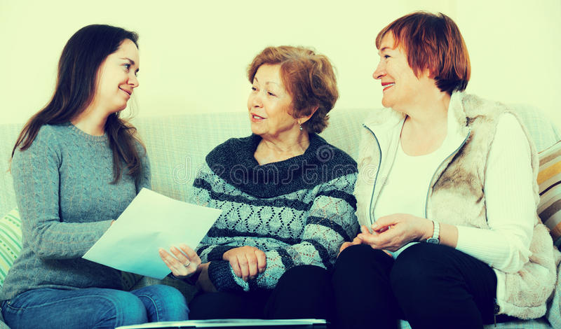 Senior women consulting with banking agent royalty free stock photo