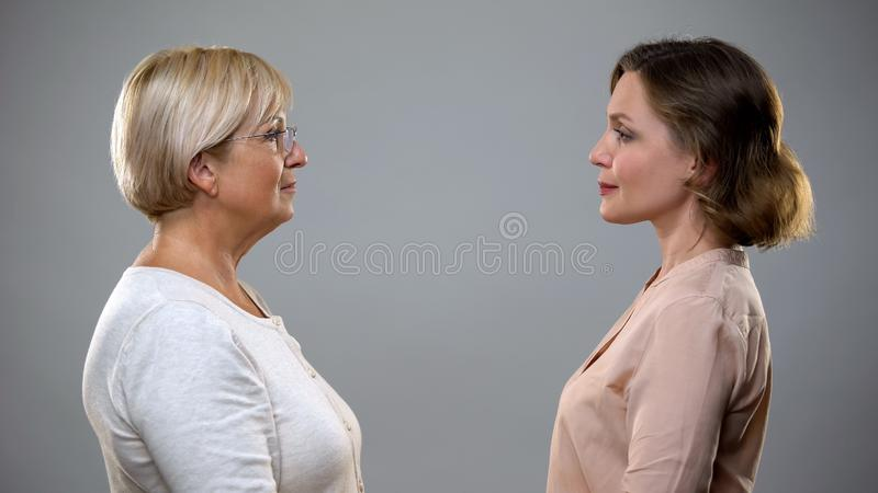 Senior woman and daughter looking at each other, support love and care relations royalty free stock photography