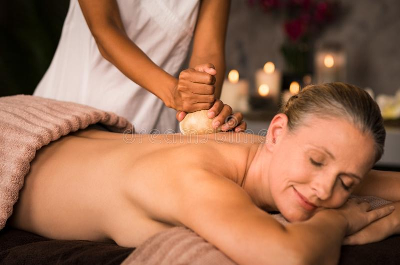 Mature woman having ayurvedic massage stock photos