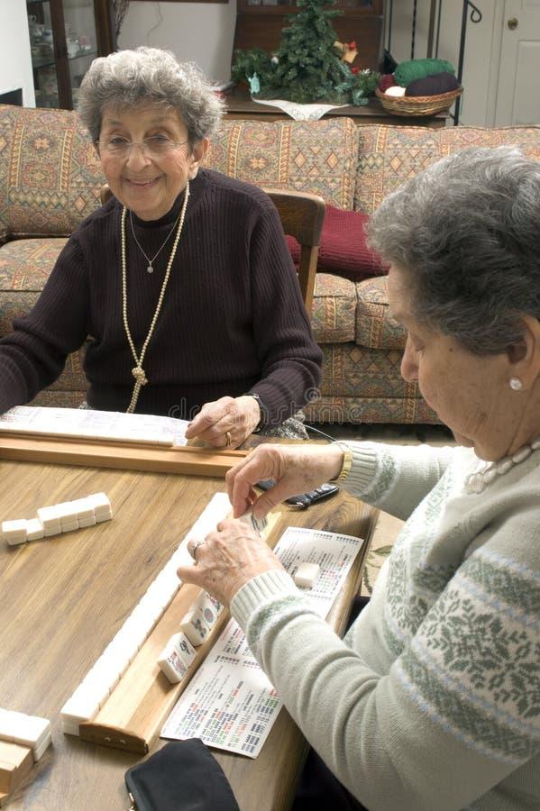senior women friends Playing mah-jong stock images