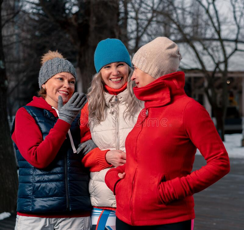 Senior Women Friends Strolling In Park After Outdoors Morning Training And Talking. Active Lifestyle at Middle Age. Senior Women Friends Strolling In Park After royalty free stock photos