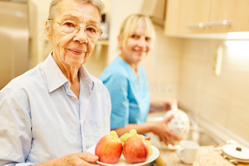 Senior and a nursing wife royalty free stock photos