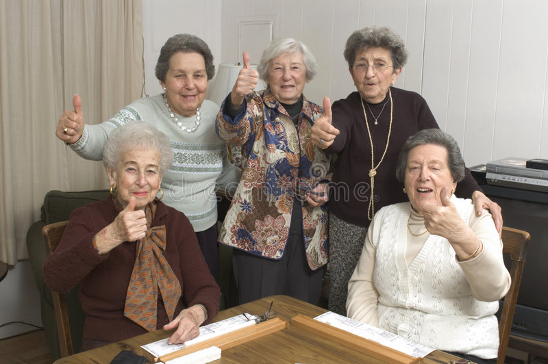 Senior women at the game table royalty free stock photos