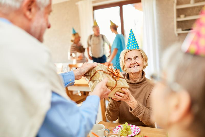 Senior woman gets birthday present royalty free stock photography