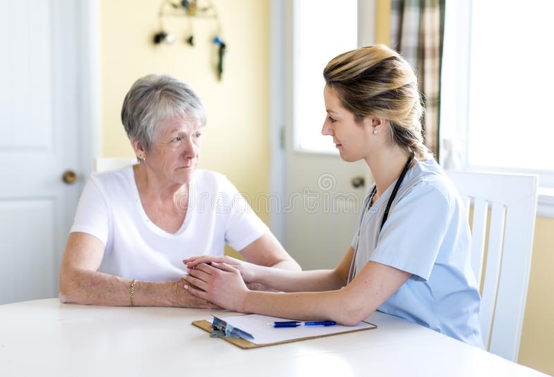 Senior woman with her caregiver at home. A Senior women with her caregiver at home stock photos