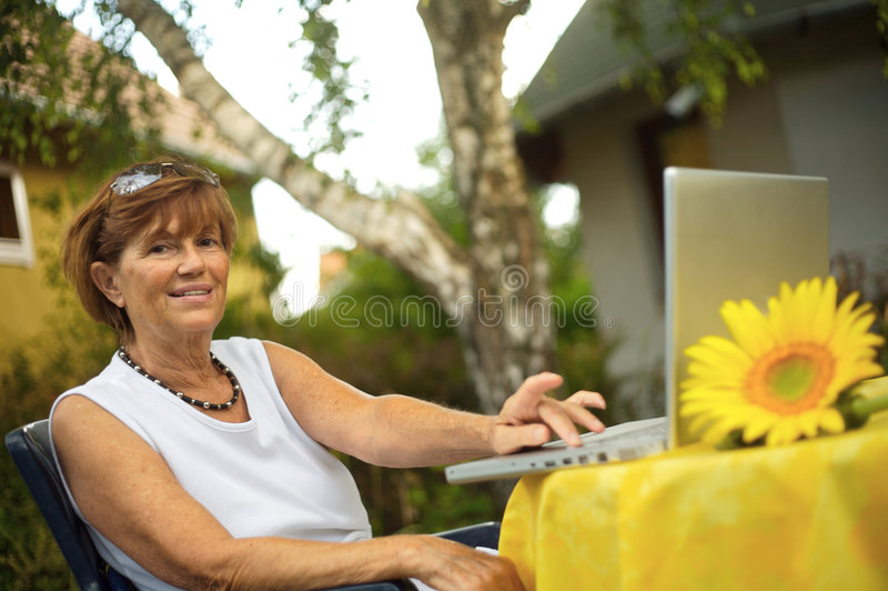 Senior women with laptop stock photo