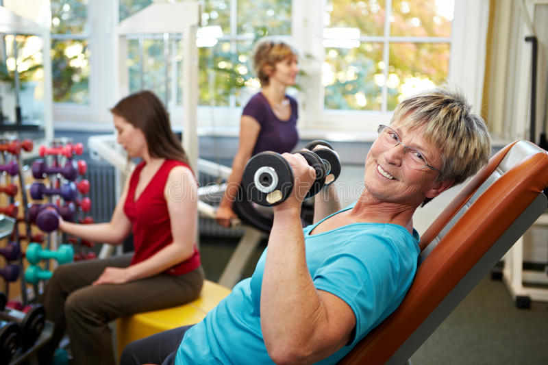 Senior women lifting weights stock photo
