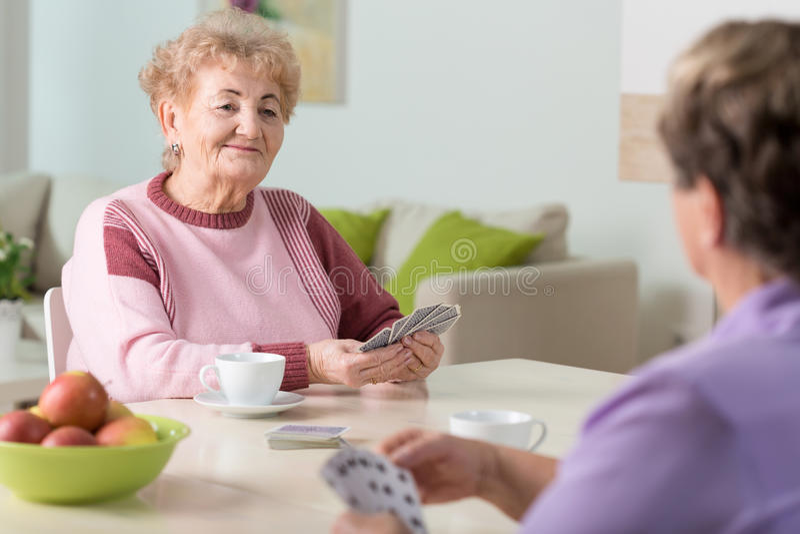 Senior women playing cards stock images