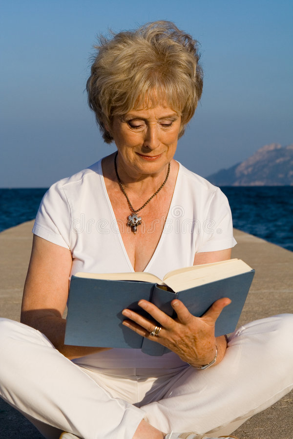 Senior women - reading royalty free stock photos