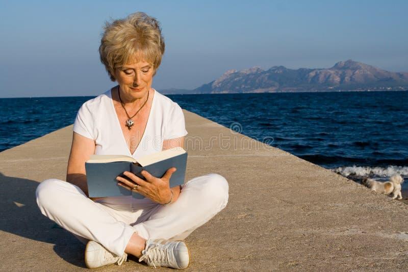 Senior women - reading royalty free stock photo