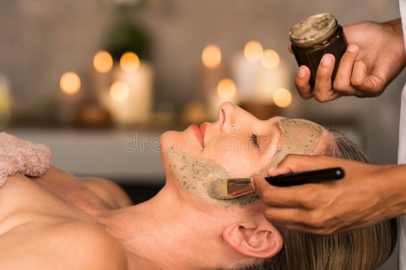 Woman with clay mask on face stock photo