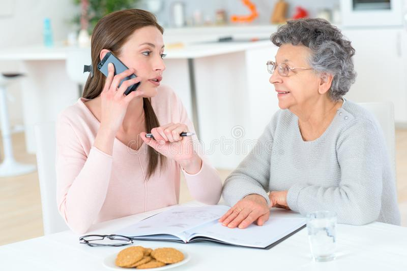 Senior woman resting with adult daughter stock photo