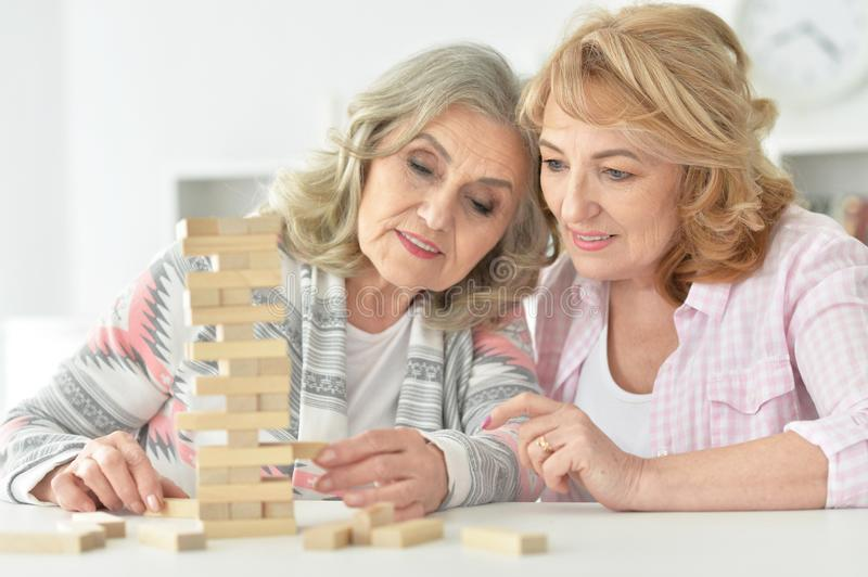 Senior couples playing with wooden blocks stock photo