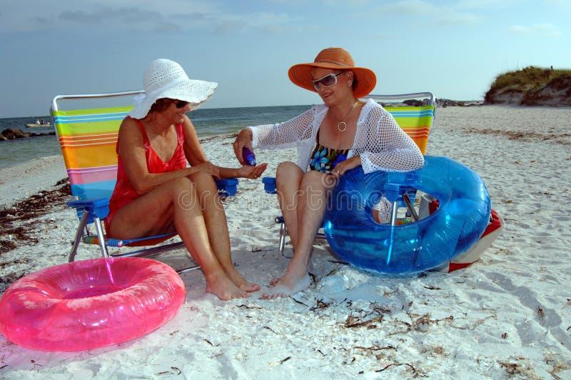 Senior women sun protection royalty free stock photos