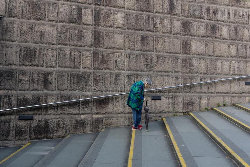 A senior women walk alone stock images
