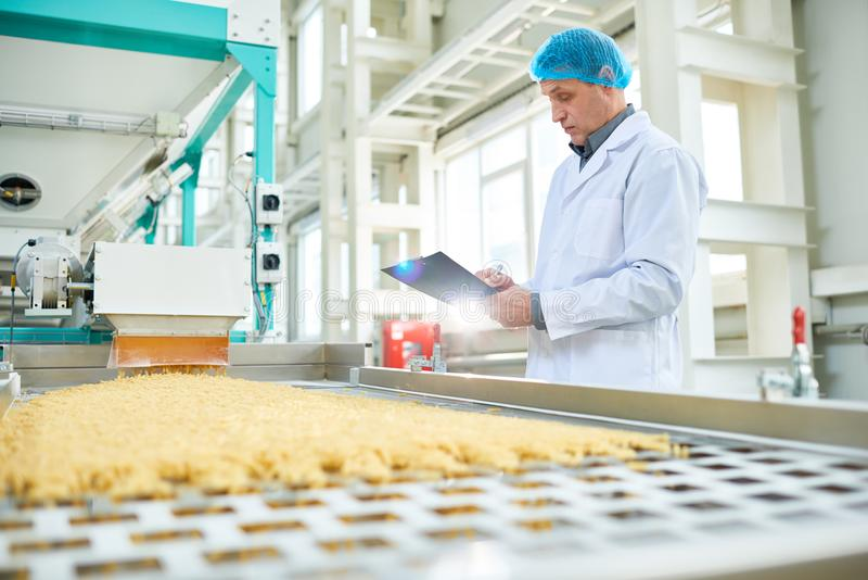 Senior Worker at Food Factory royalty free stock images