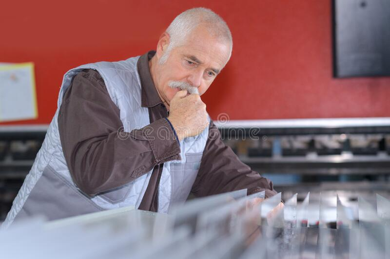 Senior worker standing in workshop royalty free stock photography