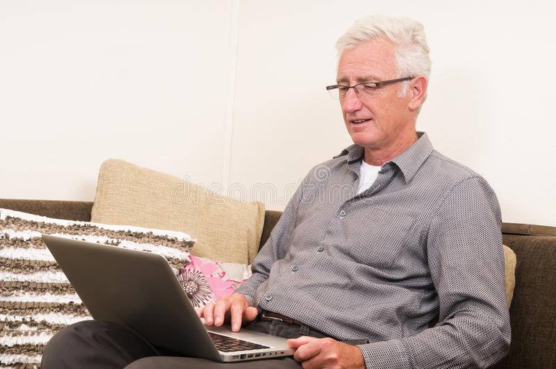 Download Senior working on a laptop stock photo. Image of happy - 20873786