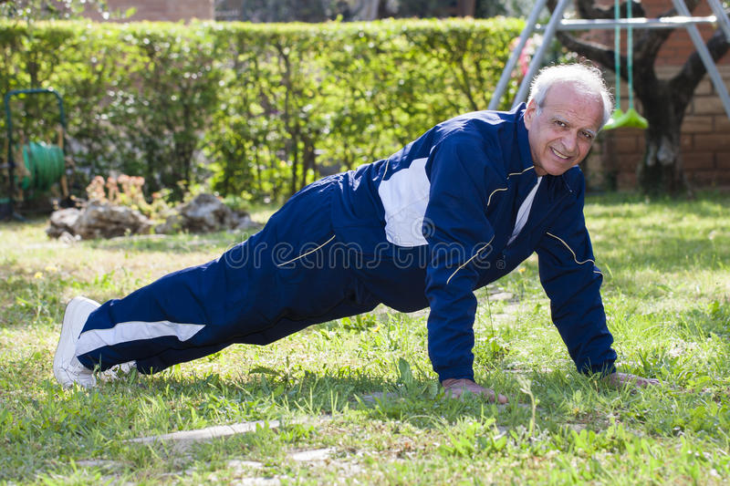 Senior Working Out Outdoor Push Up stock images