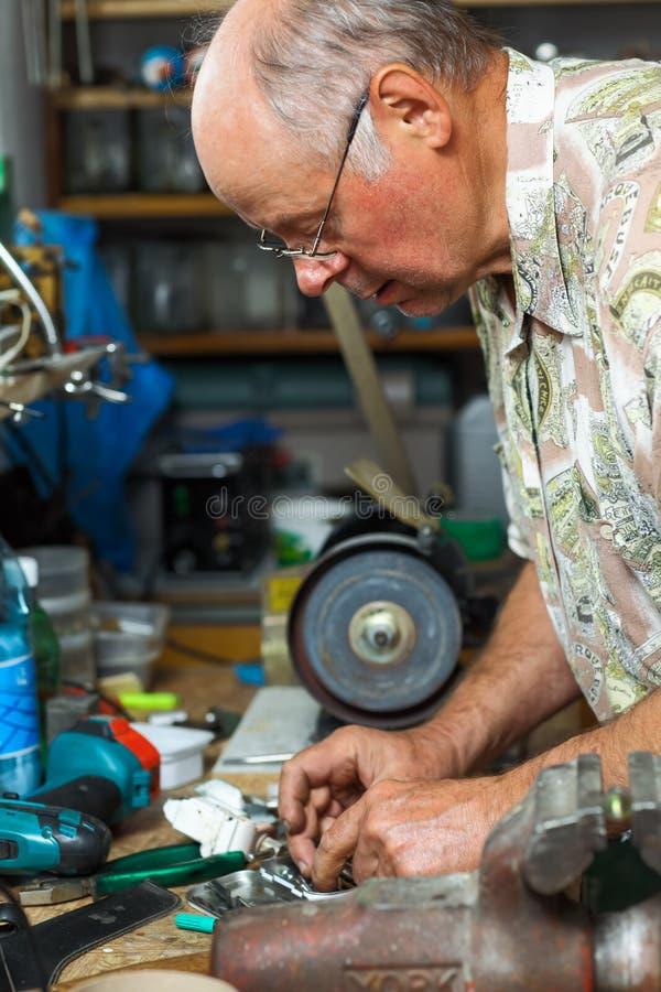 Download Senior working in workshop stock photo. Image of renovation - 26129828