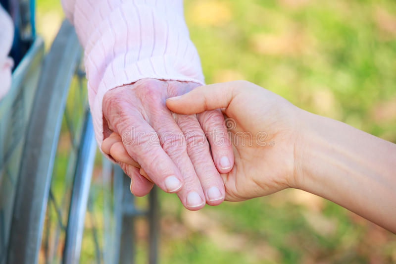 Senior and Young Women Holding Hands stock photos