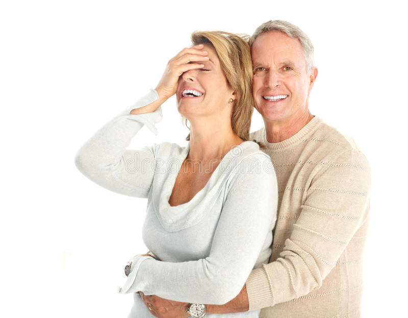 Seniors. Happy seniors couple in love. Isolated over white background stock image