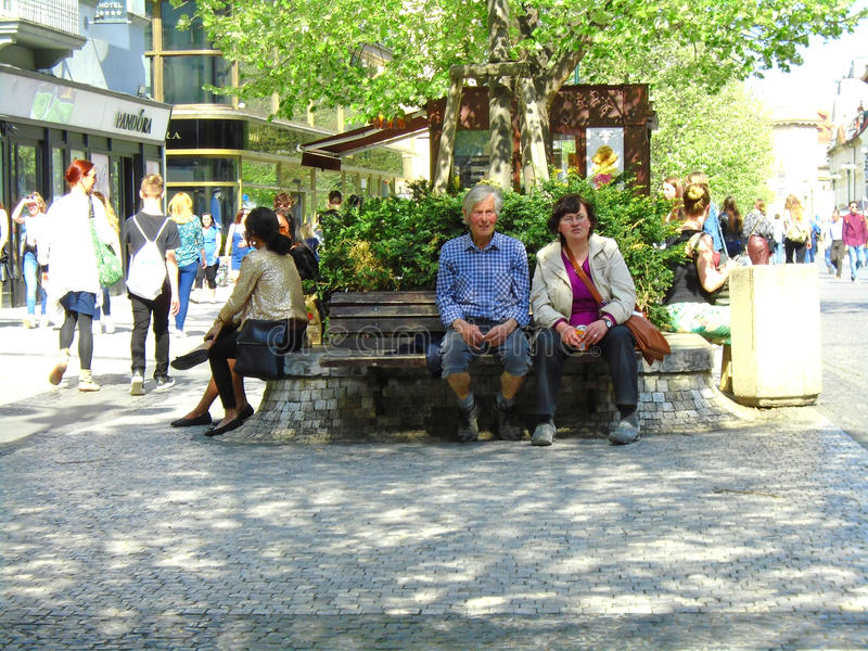 Seniors on a bench in town. Prague royalty free stock photo