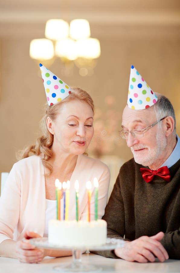 Seniors with birthday cake stock photos