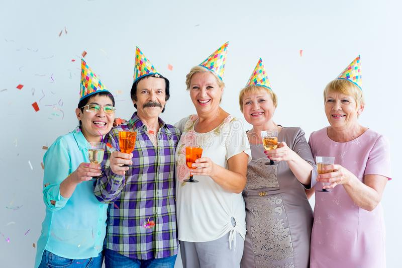 Seniors on a birthday party. Group of senior people having a birthday party royalty free stock photo